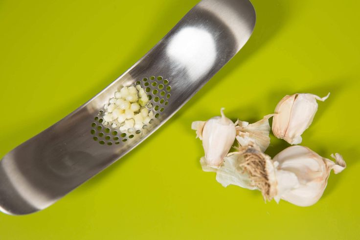 Joseph Joseph chrome garlic crusher: $10 Unlike the traditional garlic press, this one doesn't smash garlic cloves to smithereens. The rocking motion actually minces them. Bonus: cleanup is a dream.