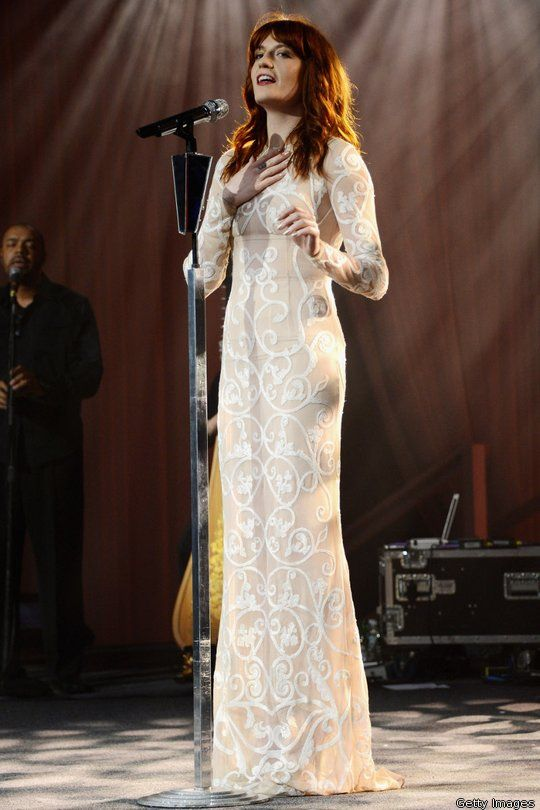 Florence Welch performing in a Jonathan Saunders white gown with filigree detail.