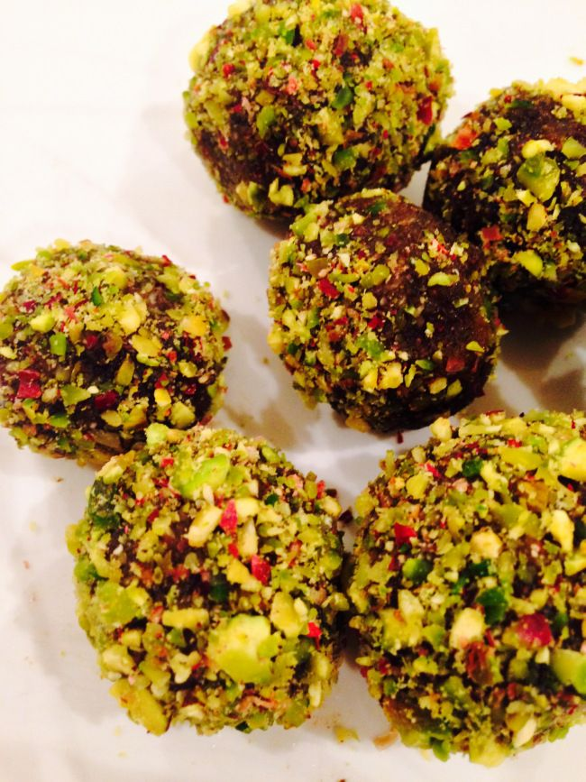 Pistachio Date Bites: 20 pitted dates, 1T. almond butter, 1/3c. crushed pistachios/coconut flakes. Blend dates & butter until smooth. Form into a ball & roll in pistachios or coconut.