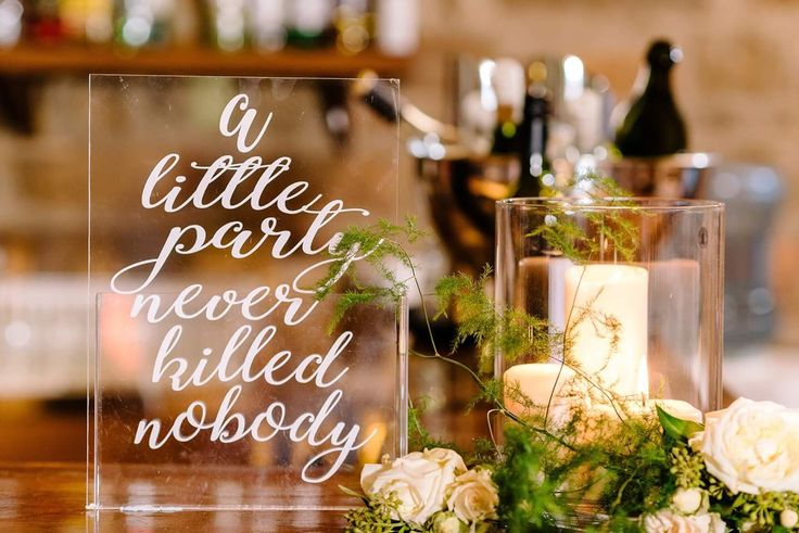 """Wedding signs """"a little party never killed nobody"""""""