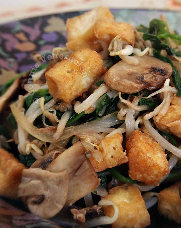 I like more than greens in my vegetable dishes. I like colors and textures and an interplay of shapes and sizes. This tofu and mushrooms with bean sprouts and spinach satisfies all those requirements.