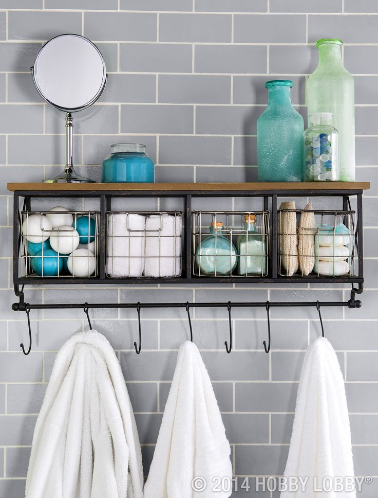 This shelf offers easy access to everyday items like lotions and a vanity mirror, while the baskets corral less-often-used washcloths and cotton balls.