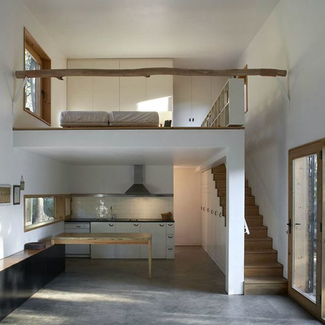 A sleek place--much prefer the stairs to a loft over a ladder for myself. tiny house ideas - bathroom behind kitchen. Stairs to loft bedroom. | Lo…