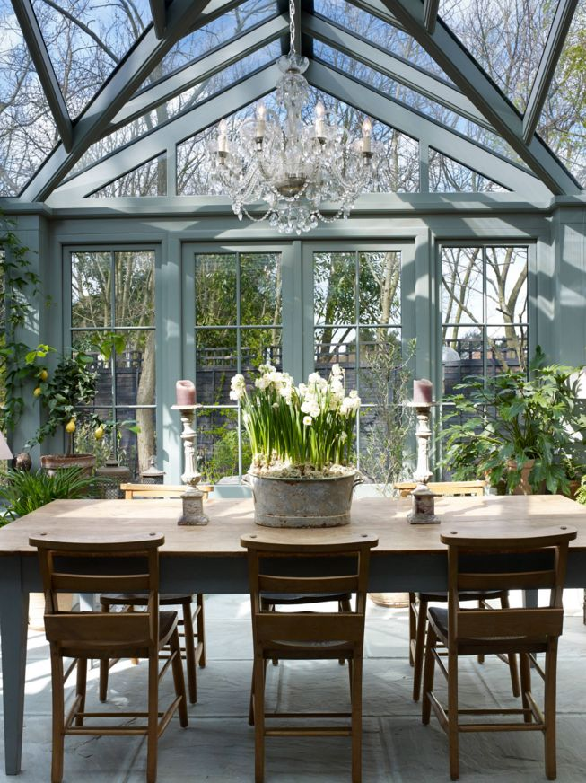 Traditional glass conservatory sunroom with a farmhouse for Farmhouse sunroom ideas