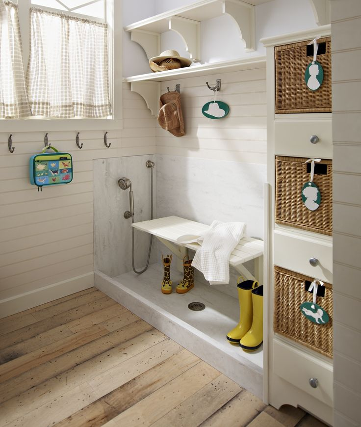 Essential to every country home -- the mudroom. And to some homes with kids, grass and gravel. Love this idea.