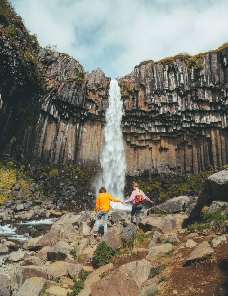 """""""Svartifoss is part of the Vatnajökull National Park located in South-Iceland. A high waterfall decorated with black rock formations behind it. To visit Svartifoss have to hike for through the beautiful national park. Iceland Road Trip, Iceland Travel, Thingvellir National Park, Iceland Waterfalls, Beautiful Waterfalls, How To Take Photos, Travel Around, Travel Photography, Couple Photography"""