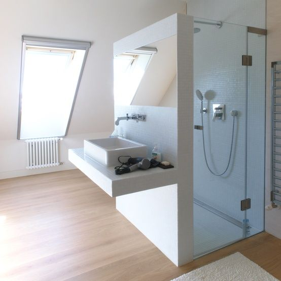 smart way to save space... well, this is not strictly a tiny apartment (you could stage a musical in this bathroom) but still like the idea of putting the sink against the shower