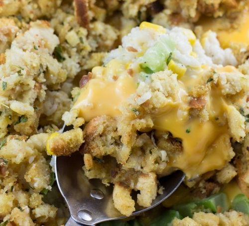 CHEESY Broccoli Stuffing Casserole recipe made with Stove Top! This is a easy dish made with frozen vegetables, cream of chicken soup, rice and Velveeta cheese! It's one of my favorite Thanksgiving side dishes! If you want to make it Vegetarian use cream o