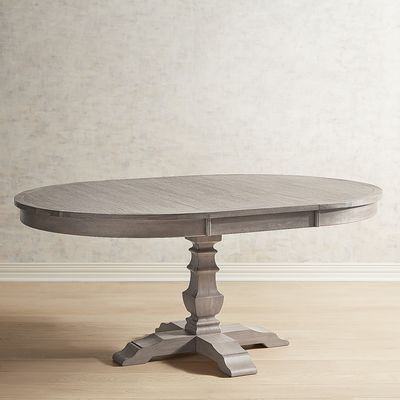 Traditional meets subtle rustic for casual or formal dining. Crafted of hardwoods, our handsome Bradding extension table comfortably seats up to six (with leaf) and features a warm, gray finish and an urn-shaped pedestal base. When not needed, remove the leaf and enjoy a more compact round table (seats four).