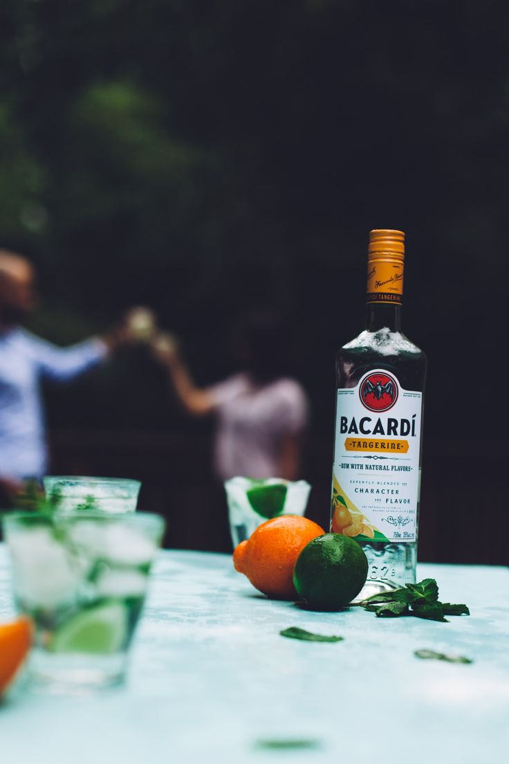 Tangerine mojito, yum! All you need is mint leaves, 1 lime, seltzer water, ice, and Bacardí Tangerine Rum. [sp]