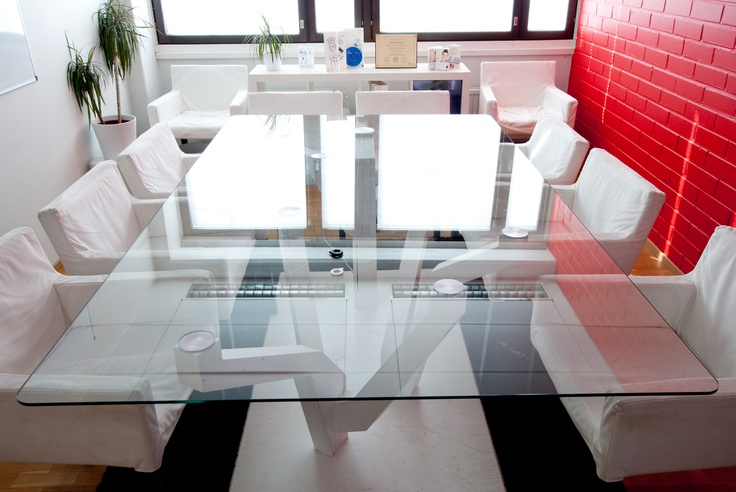 The wireless charging meeting room table designed by @jukkaitala and located at PowerKiss HQ