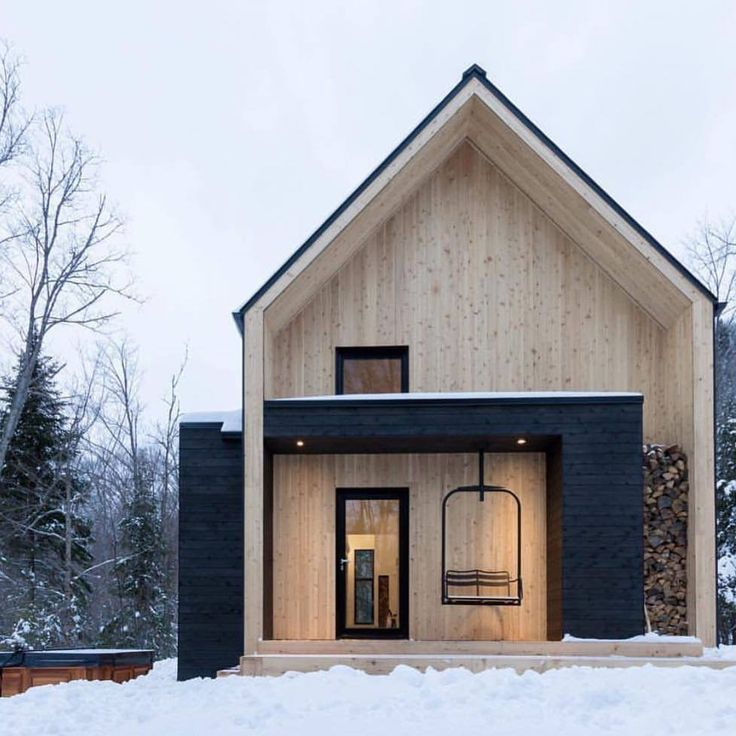 Nordic shape cabin and we love the use of a retired ski lift chair for a swinging chair :)