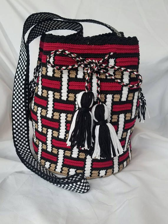 Beautiful Mochila Bag with basketweave pattern by SunnyCreekStitches. 100% mercenized cotton. Measures 8×7 with 30 strap. The black and white strap was made on an inkle loom. Long draw string to keep closed and has matching tassels on end. It has a star like pattern on the bottom