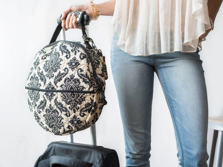 Travel in comfort and style with this elegant ensemble, including a zippered carrying case, bag tag and padded luggage handle grips.