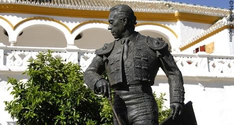 This is a picture taken outside of Plaza de Toros de Ronda in Sevilla. The statue represents famous bullfighter Curro Romero. He had a 42 year long career, and retired at a fairly old age of 66. He has received many awards and has long time supporters. His regal strong pose shows how admired toreros are in Spanish society.