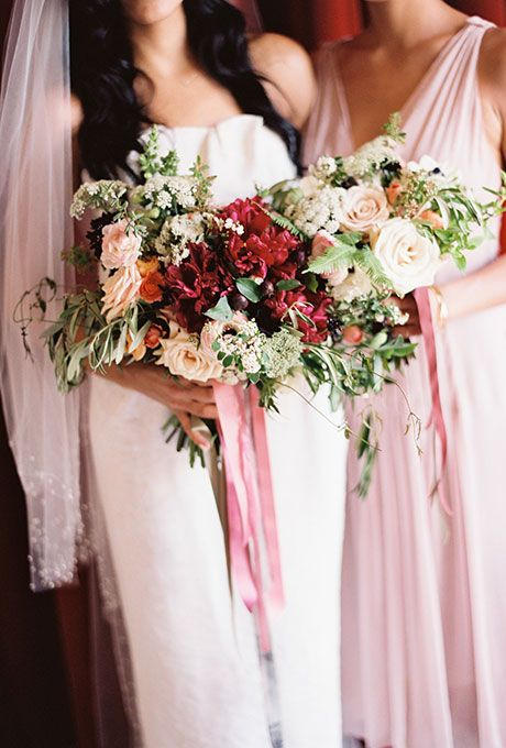 Fall Wedding Bouquet: Red and White Ranunculus, Poppies, Roses, and Greenery | Brides.com