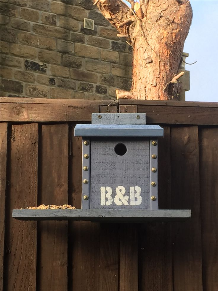 Bird B&B, painted in custom-mix blues from the Annie Sloan Chalk Paint range, brass studs added for decoration and stencilling.