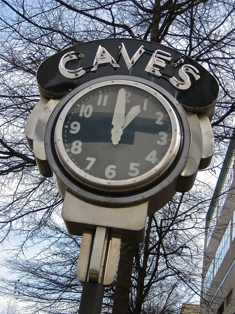Old neon clock on a street in downtown Little Rock, AR at Cave's,