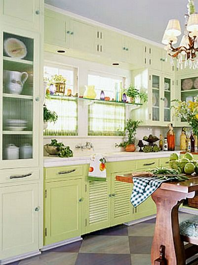 1920s kitchen featured in BHG-----love the window treatment with the glass shelf and curtain panels: