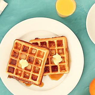 Easy Waffles 1 cup all-purpose flour, spooned and leveled 2 tablespoons sugar 1 teaspoon baking powder 1/4 teaspoon salt 1 cup milk 2 large eggs 4 tablespoons (1/2 stick) unsalted butter, melted Maple syrup and butter, as desired, for serving Directions Preheat waffle iron according to manufacturer's instructions. In a large bowl, whisk flour, sugar, baking powder, and salt; set aside. In a small bowl, whisk milk and eggs; pour over flour mixture, and
