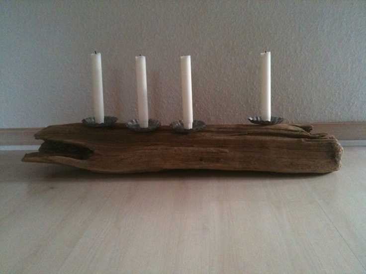 A piece of drift wood and 4 candles.