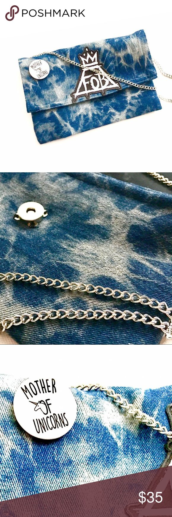 """Slim Silhouette Denim Clutch bag Custom Handmade Denim Slim Silhouette Clutch bag. Detachable 42"""" Silver Crossbody shoulder chain. Simply hold it in your hand or attach the delicate silver chain to wear it across the body. Flap over opening with magnetic snap. 'Mother of Unicorns' pin . Width 8"""", Length 6"""".  Cool and confident, this silhouette slim Clutch Blue Denim is a wear-anywhere indulgence. Bags Crossbody Bags"""