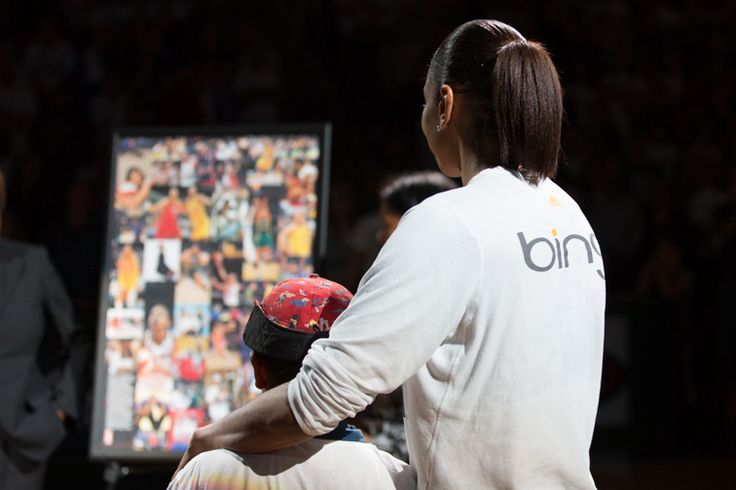 Tina and son Dyllan are presented with a gift from the WNBA. Photo credit: Neil Enns/StormBasketball.
