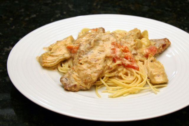 Get this flavorful veal recipe made with cream, artichokes, and wine. An easy veal cutlet recipe with a creamy sauce.
