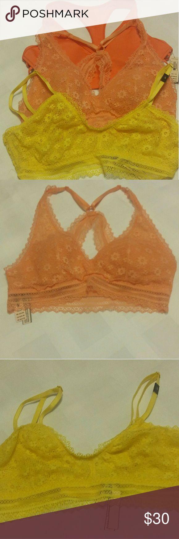 Bras Victoria Secret bras, one orange,  one yellow size s/p/ch 100% polyester and elastane. One sports bra orange size extra small /tees petite  (body-wick keeps you cool & dry. Victoria Secret Intimates & Sleepwear Bras
