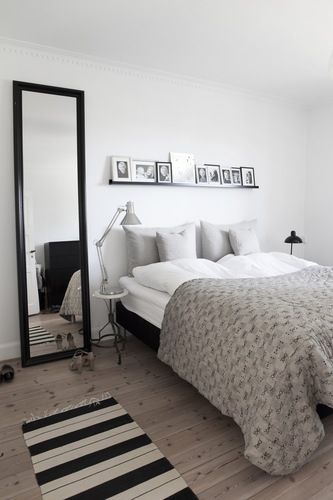 BO BEDRE. Simple bedroom. Love the shelf over the bed and black framed mirror