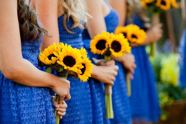 Love these colors - cornflower blue bridesmaids dresses, yellow sunflower bouquets, rustic blue and yellow wedding, Kim J Martin Photography