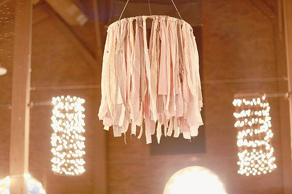 fabric chandelier hung on hula hoop  in the background - tomato cages hung with white lights covering them - great idea!  ( @Connie Hamon Hamon Mercer )