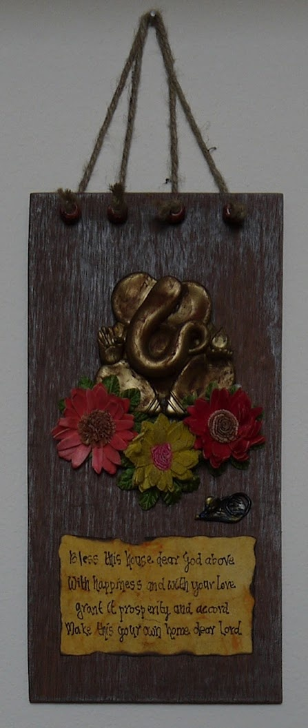 ganesha (vakratunda) on polished indian wood: rustic look at house entry