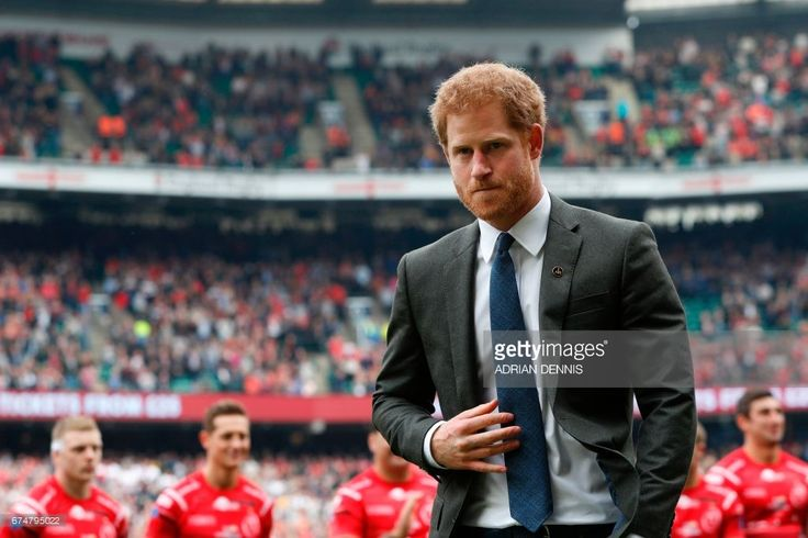 Britain's Prince Harry walks off the pitch to take his seat in the crowd to watch the annual Army Navy armed forces rugby match at Twickenham, west London, on April 29, 2017.Prince Harry attended the Army Navy match at Twickenham as Patron of the Invictus Games Foundation, which is the Official Charity of the day for this years match. The Army Navy Match is the annual rugby union match between the senior XV teams of the Royal Navy and British Army. This year sees the 100th fixture. / AFP…