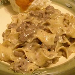 Simple Beef Stroganoff ■1 (8 ounce) package egg noodles  ■1 pound ground beef  ■1 (10.75 ounce) can fat free condensed cream of mushroom soup  ■1 tablespoon garlic powder  ■1/2 cup sour cream  ■salt and pepper to taste