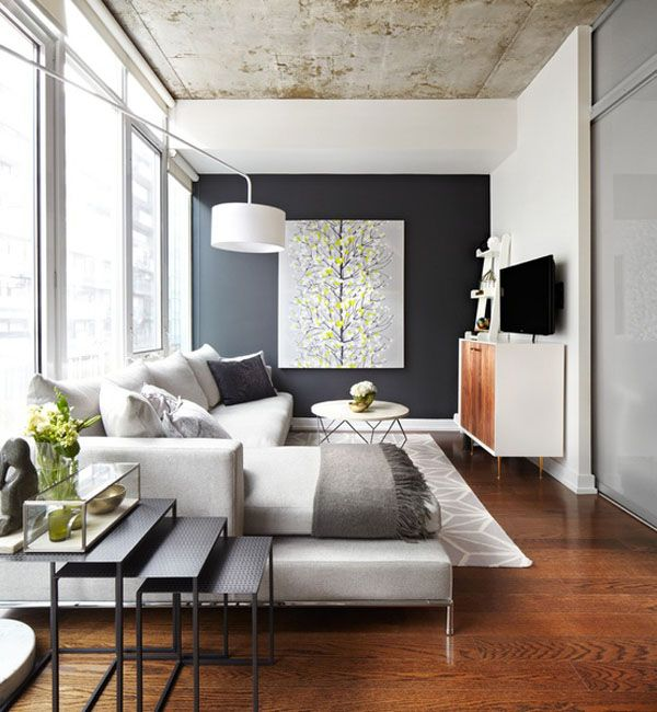 Light grey geometric rug, credenza, nesting tables and display, concrete ceiling