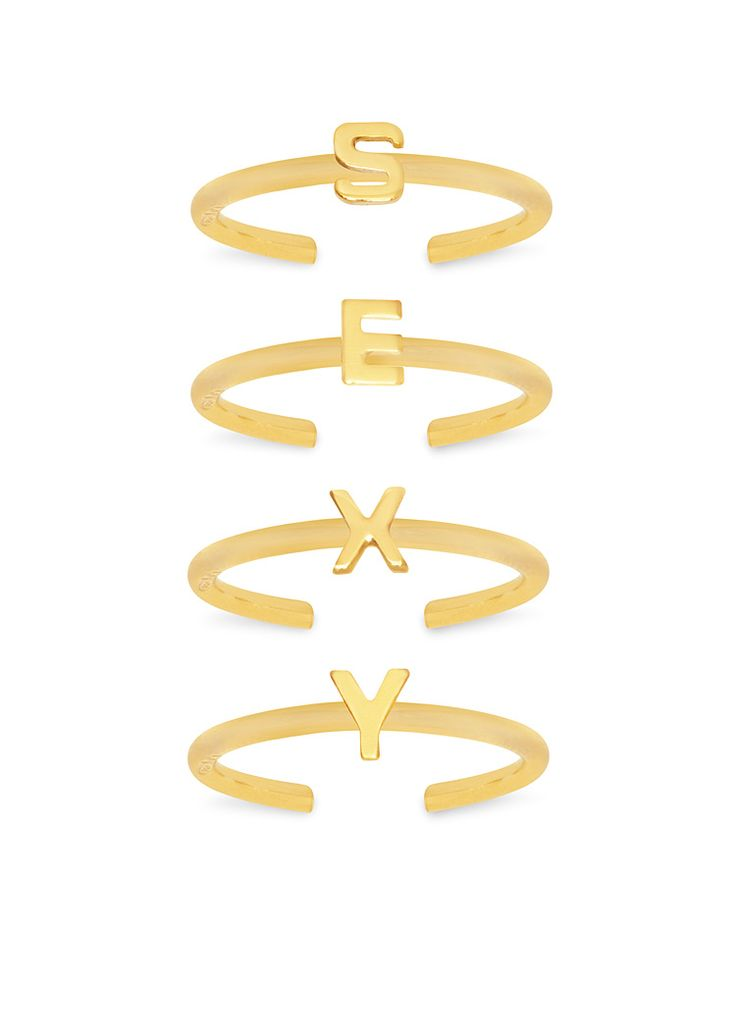 'Punk Kiss' midi ring set of 4 : a stackable set of Sterling Silver thin band midi rings, with small cut-out letters  spelling 'SEXY'.