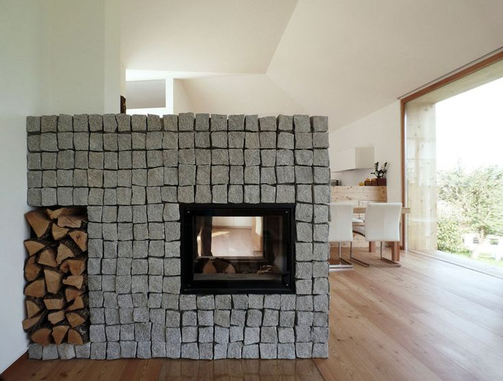 Fireplace Design Idea - 6 Different Materials To Use For A Fireplace Surround // Stone has been used to create this fireplace surround.