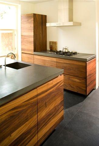 Maybe this darker concretey worktop CaesarStone (Raven) kitchen worktop by Erbi - Fred Constant