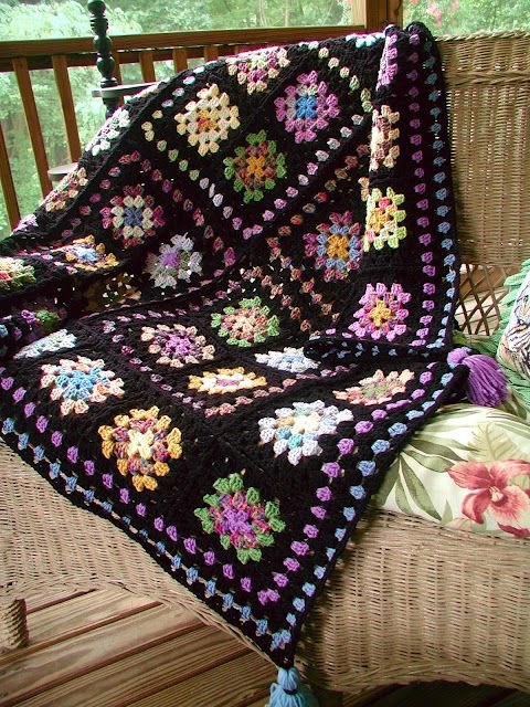 Classic Granny Square Afghan...check out the pictures of her finishing touches to it!