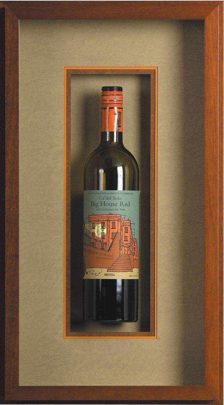 What an awesome idea for this wine bottle! It's preserved in a beautiful shadow box made of a chestnut colored frame. www.westdesmoines.thegreatframeup.com