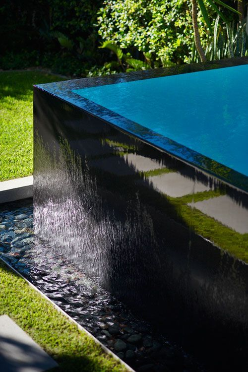 Black Tiled Pool Infinity Edge Pebbles In Trough