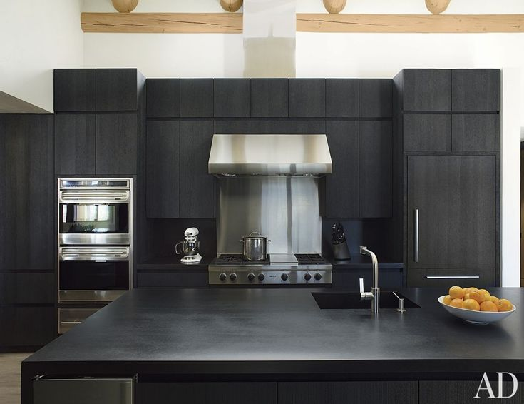 cabinetry of blackened wire brushed oak and countertops of