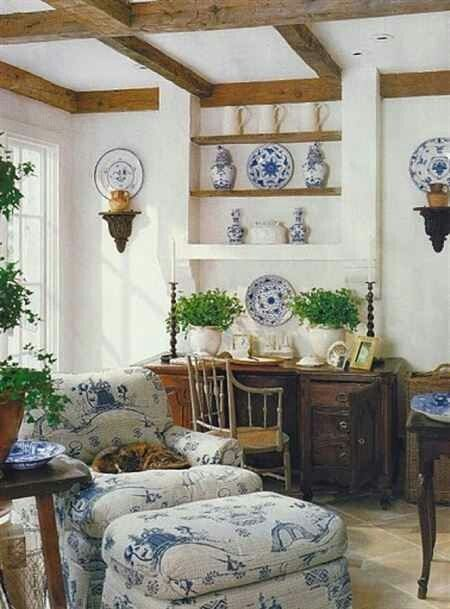 French Cottage Blue and White with rustic woods....love the ceiling beams and the use of antiques in the room!