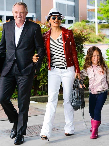 Salma Hayek strutted her stuff in a bright red leather jacket, fedora and round sunnies in Italy, with her equally trendy hubby and daughter in tow!