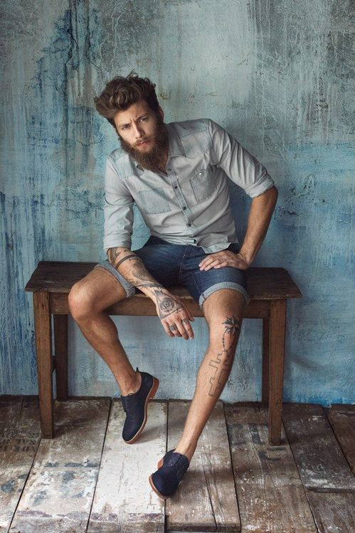 denim shorts and collared shirt.