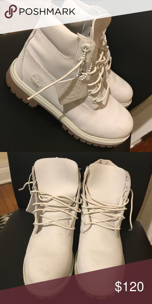 White timberland boots White timberlands size 4.5 which Is about a size 7 in women's. barely worn. One small red stain on the inner side of the boot and is barely noticeable. Timberland Shoes Combat & Moto Boots