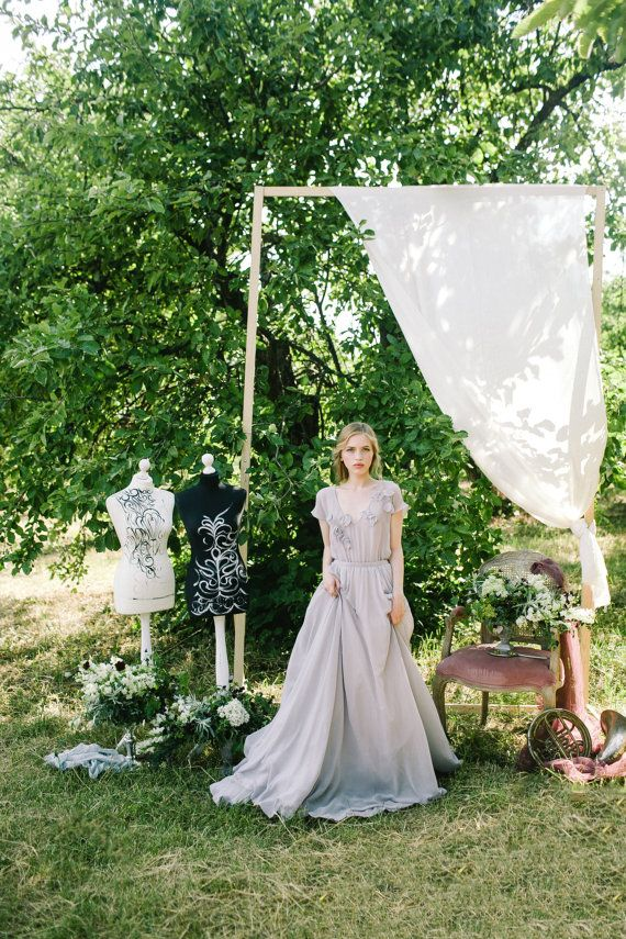 Gentle short sleevs grey bohemian wedding dress with floral / http://www.deerpearlflowers.com/unique-sophisticated-wedding-dresses-from-cathy-telle/2/