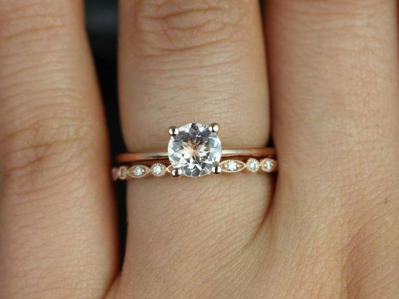 This engagement ring is perfect for those who are classics! This clean design is both feminine and practical. All stones used are only premium cut,