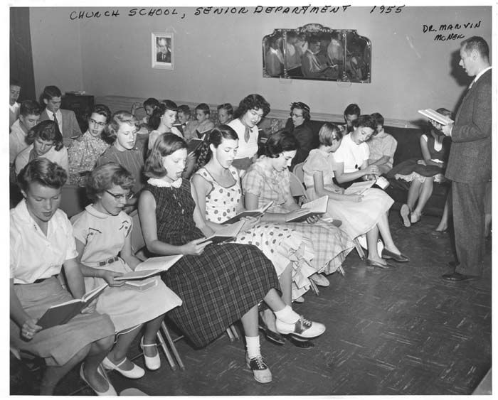 Students attending class at the church school, senior department at the Woodland Hills Community Church and Community Center at 21338 Dumetz Road, 1955.  	Woodland Hills Community Church. San Fernando Valley History Digital Library.